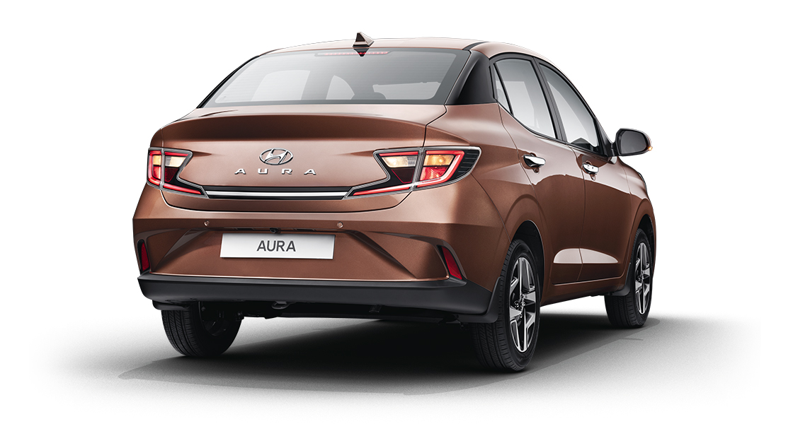 Right side rear view of red Aura