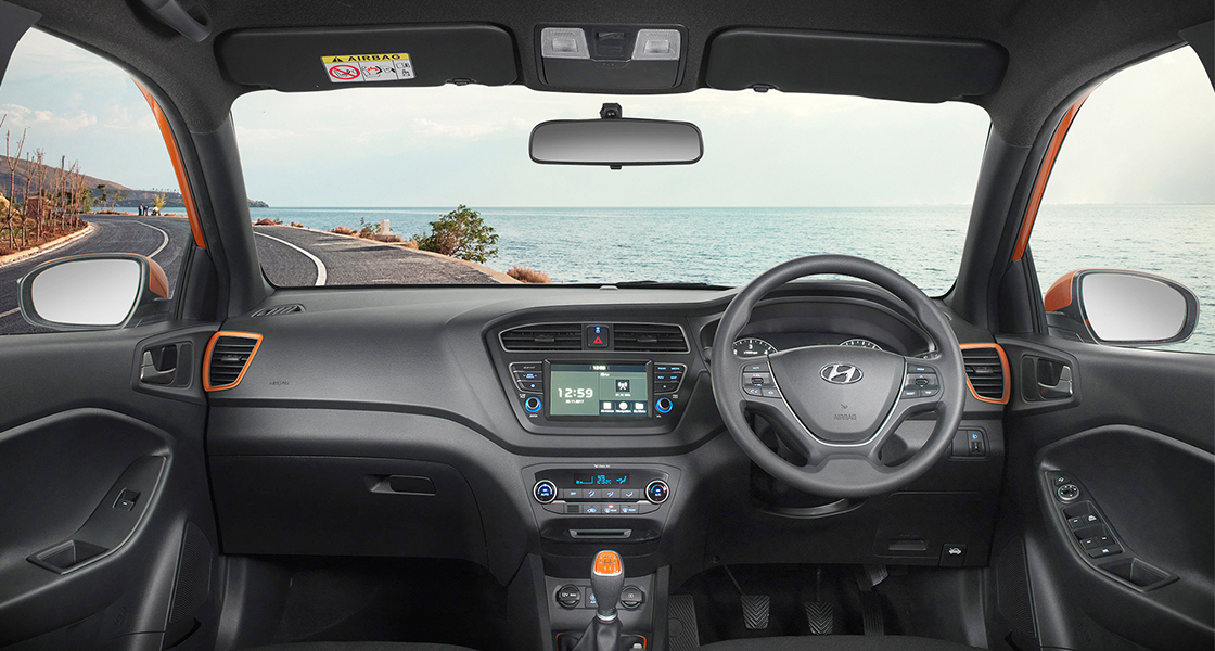 Panoramic view of front seats black and beige color interior