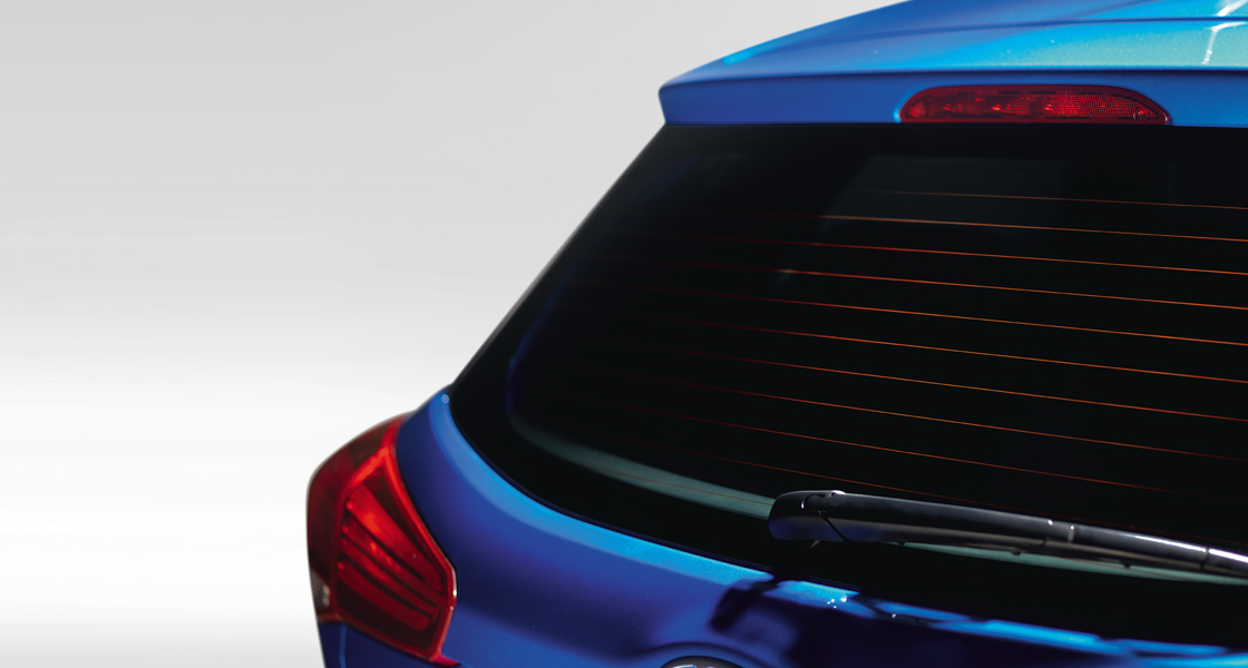 Rear view of red Elite i20's rear defogger