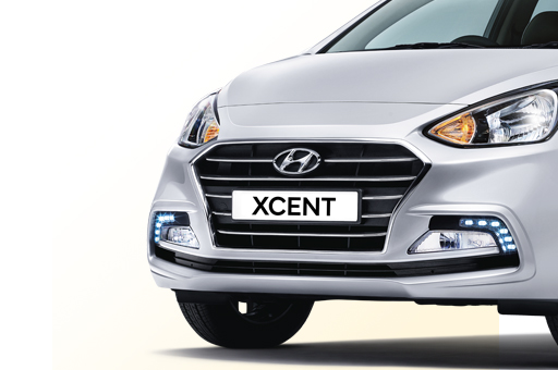 Radiator grille with Xcent logo