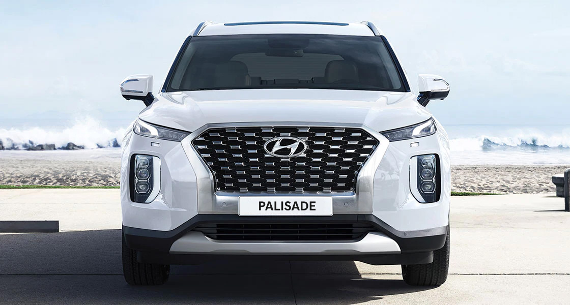 Left side front view of white Palisade