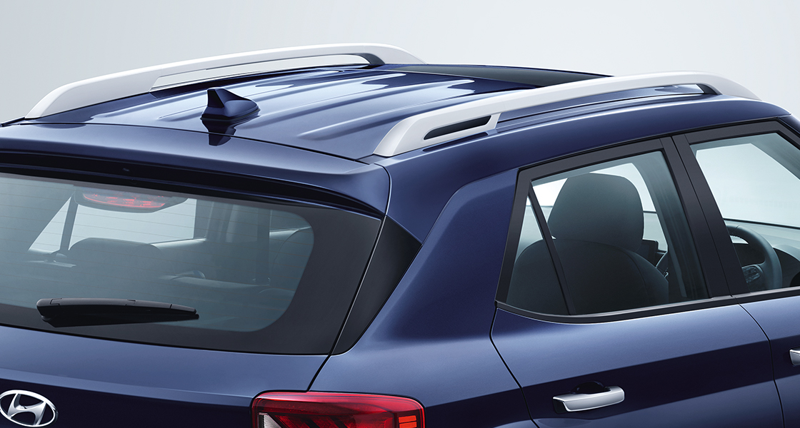 Side view of blue Tucson